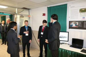 A Computer Science team discusses their project display