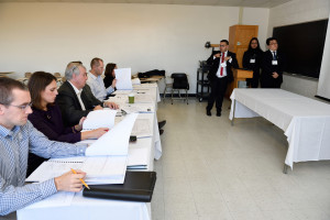 Civil Engineering judges review the team's report