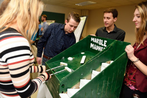 Visitors play Marble Madness, created by Mechanical Design I students