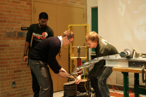 Mechanical Design II students add weight to their deployable bridge