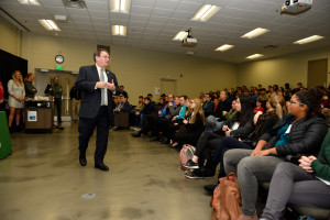 Dean Kempel addresses visiting high school students and their chaperones