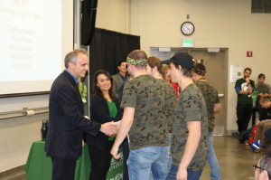 The winning Mechanical Design I team is congratulated by Michael Lavagnino