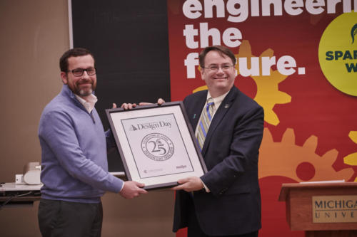 Terry Ledbetter, CIO of Meijer, accepts the Design Day 25th Anniversary plaque