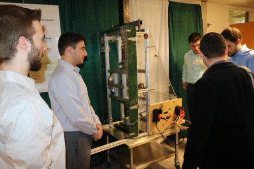 The Mechanical Engineering Fraunhofer team discusses their project with visitors