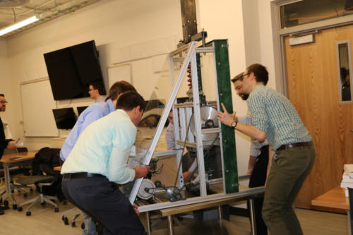The Mechanical Engineering Fraunhofer team maneuvers their project to their presentation room