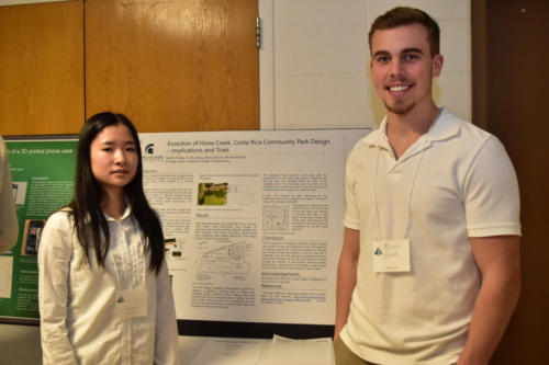 Freshman Engineering students with their project poster