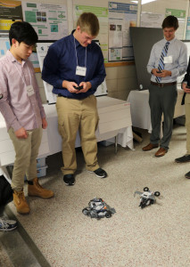 Two EGR 100 students demonstrate their robots