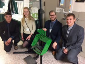 ME students show off their Tractor Step Bracket which aids farmers with disabilities