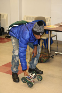 A high school visitor prepares to test his VEX Robotics Vehicle