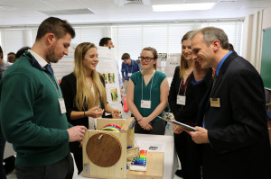 ME 371 students play their mechanical xylophone for visitors