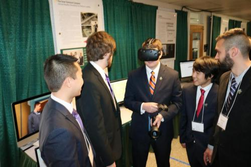 Visitors experience Team Dow's Virtual Reality Simulation for Railcar Loading