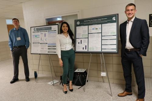 Chemical Engineering students wait to discuss their poster projects with attendees