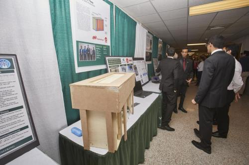 Visitors wander the halls to view all of the capstone project displays