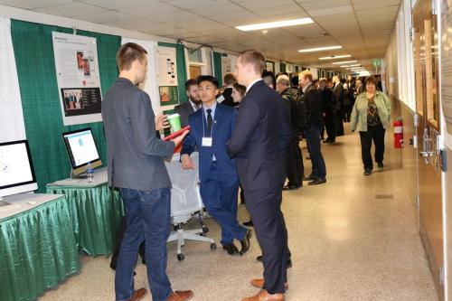 Capstone posters and projects are on display in the hallways during Design Day