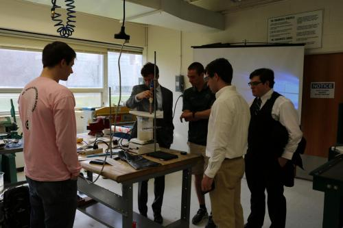 A Heat Transfer team prepares their heat pipe for competition