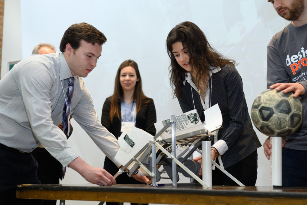 """An ME Design II team prepares their """"Pick and Place"""" device for competition"""